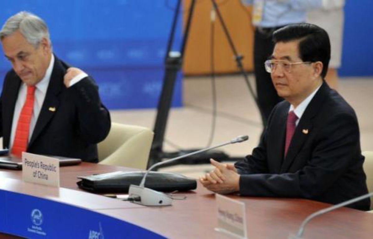 Le président chinois Hu Jintao a appelé samedi tous les pays d'Asie-Pacifique à préserver la paix et la stabilité, peu avant l'ouverture d'un sommet qui devrait être dominé par les disputes territoriales récemment ressurgies dans la région. – Yuri Kadobnov afp.com