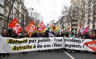 Des manifestants défilent à Paris le 14 janvier 2020 contre la réforme des retraites.