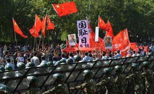 """Pékin a décidé dimanche de """"repousser"""" une cérémonie marquant le 40e anniversaire de la normalisation des relations entre la Chine et le Japon, sur fond de vives tensions entre les deux pays pour des questions territoriales, ont indiqué l'agence chinoise officielle et une source diplomatique japonaise."""