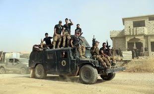 Les forces d'élite irakiennes se rassemblent en vue de reprendre la ville de Mossoul, le 15 octobre 2016.