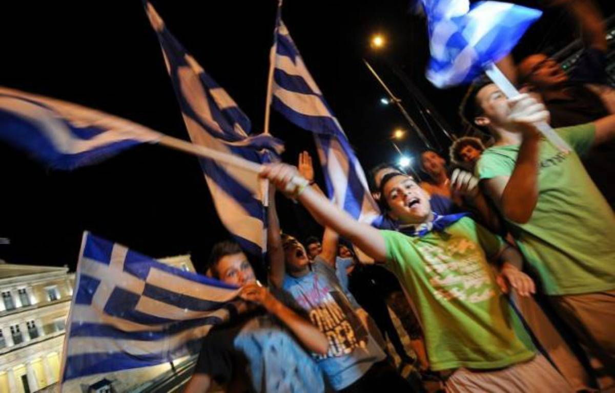 Quand la Grèce affrontera l'Allemagne vendredi en quart de finale de l'Euro-2012 à Gdansk, la nation entière, avec la volonté d'en découdre avec un pays dont les dirigeants sont facilement érigés en bouc-émissaire, sera rivée à sa télévision. – Andreas Solaro afp.com