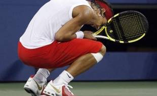 Rafael Nadal of Spain celebrates match point against Mardy Fish of the U.S. during their match at the U.S. Open tennis tournament at Flushing Meadows in New York September 4, 2008. REUTERS/Shaun Best (UNITED STATES)