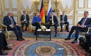 Vendredi 2 octobre, Angela Merkel, Vladimir Poutine et Petro Porochenko étaient invités à l'Elysée.