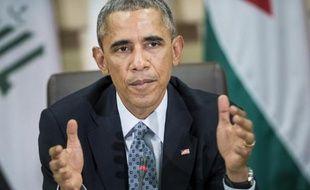 Le président américain Barack Obama s'exprime après une rencontre avec les chefs militaires des 22 pays de la coalition anti-EI dans une base de l'Air Force située dans le Maryland, le 14 octobre 2014