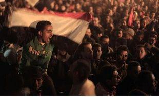 Des Egyptiens en liesse, sur la place Tahrir, après le départ d'Hosni Moubarak, le 11 février 2011.