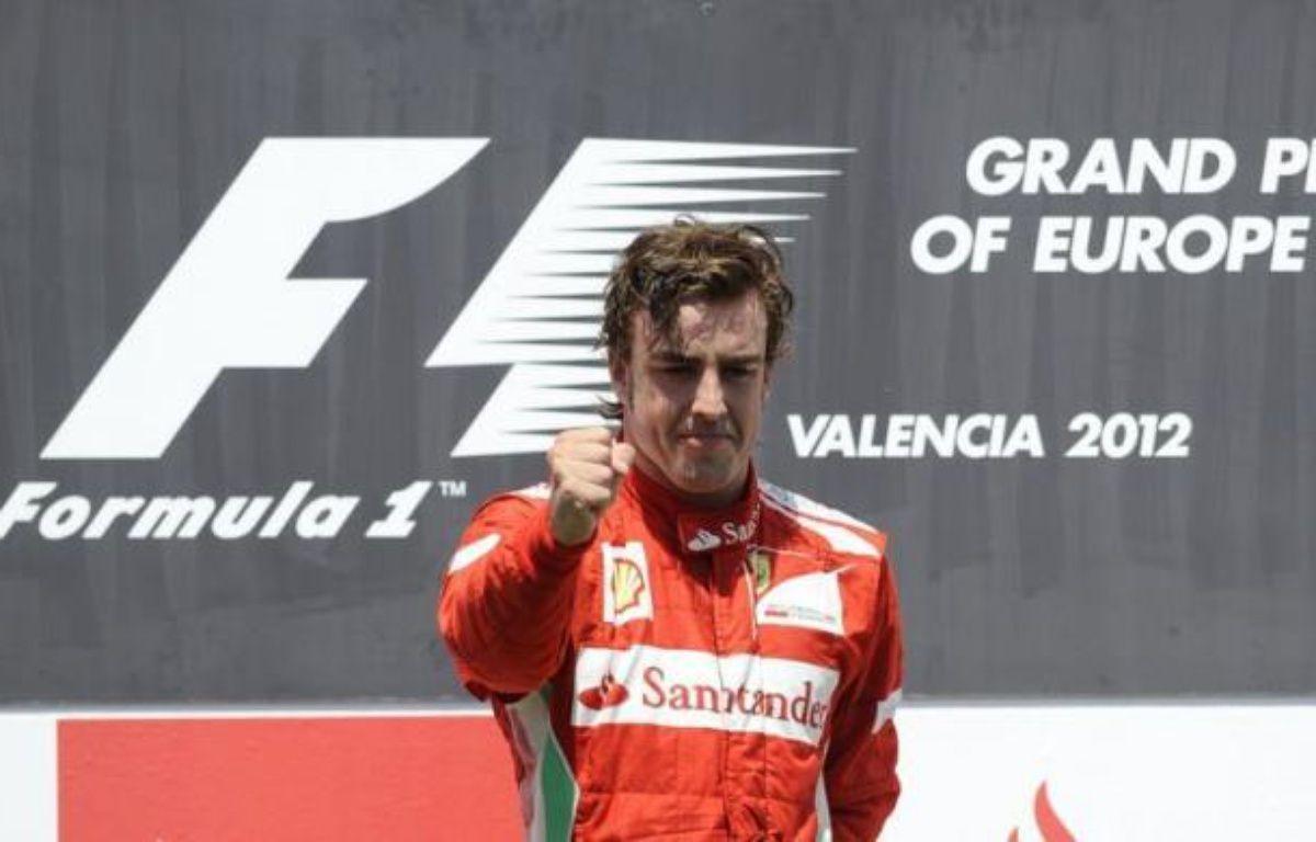 L'Espagnol Fernando Alonso (Ferrari) a remporté dimanche à Valence, devant son public, un GP d'Europe qui rentrera à coup sûr dans les annales de la Formule 1, devant le Finlandais Kimi Räikkönen (Lotus-Renault) et l'Allemand Michael Schumacher (Mercedes). – Rafa Rivas afp.com