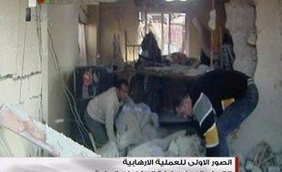 Des images de la télévision publique syrienne après le double attentat suicide visant des installations du service de sécurité le 23 décembre 2011.