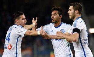 Billel Omrani félicité par Florian Thauvin et André-Pierre Gignac après son but lors de Montpellier-OM, le 9 janvier 2015.