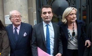 Jean-Marie Le Pen, président d'honneur du FN, Florian Philippot, vice-président et Marine Le Pen, présidente du FN, le 24 avril 2014 à Paris.