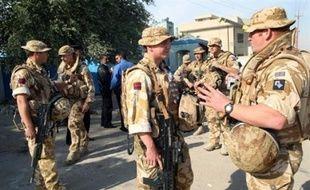 La crise parlementaire a retardé lundi le vote d'une résolution mandatant le gouvernement pour signer des accords permettant aux troupes étrangères non américaines, essentiellement les Britanniques, de rester en Irak après l'expiration du mandat de l'ONU le 31 décembre.
