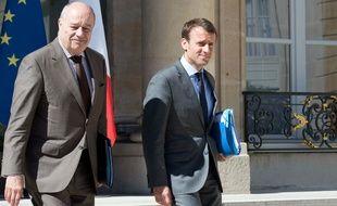 Jean-Michel Baylet et Emmanuel Macron en juillet 2019, à la sortie d'un conseil des ministres.