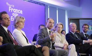 A droite de l'image, Michèle Alliot-Marie, Brice Hortefeux et Jérôme Lavrilleux lors d'un conférence de presse de l'UMP à Paris le 24 avril 2014.