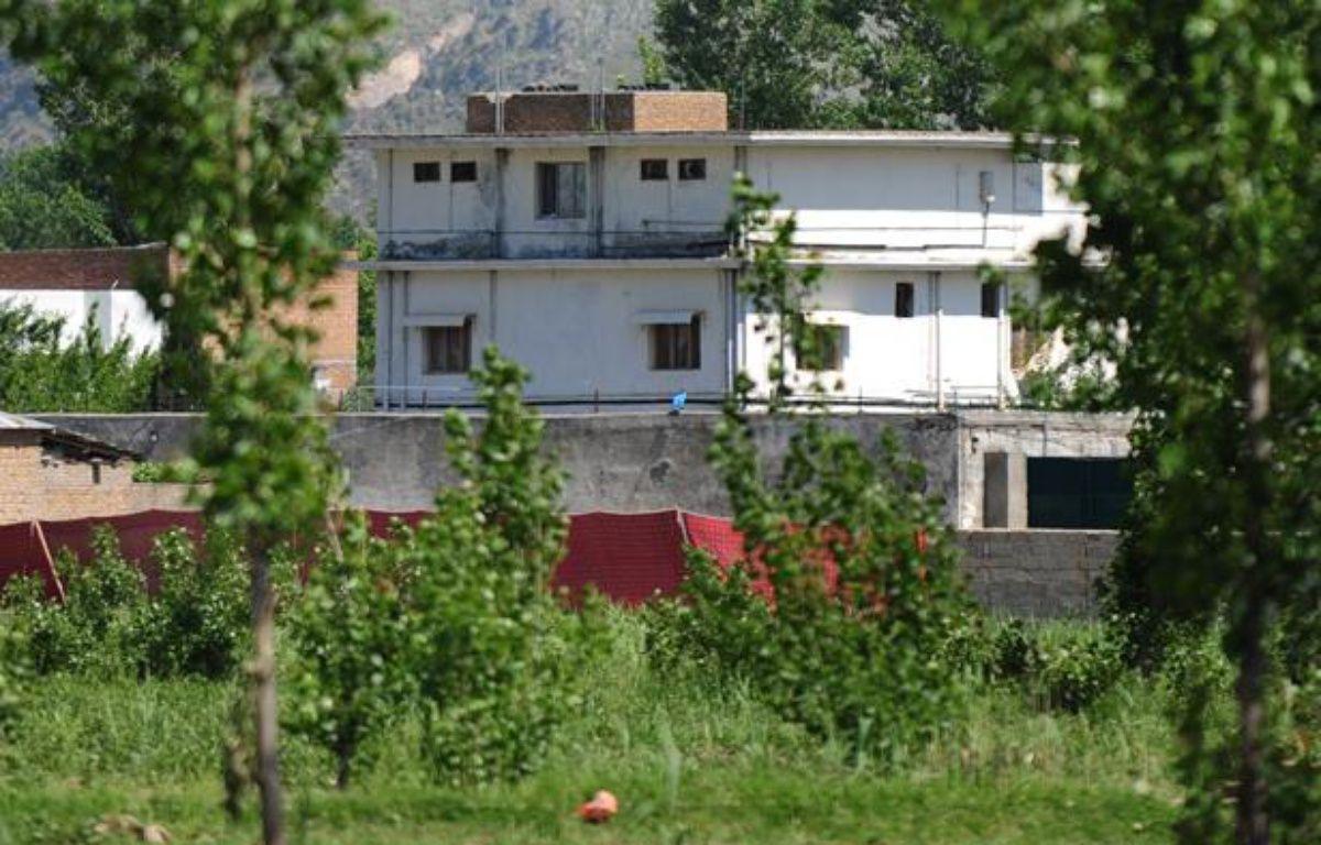 Photographie de la maison dans laquelle se cachait Oussama ben Laden, prise après l'assaut du commando américain, le 2 mai 2011 à Abbottabad, au Pakistan. – F. NAEEM / AFP