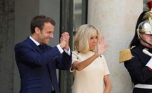 Emmanuel et Brigitte Macron, le 11 juillet à l'Elysée.