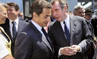France's President Nicolas Sarkozy (foreground) accompanied by Centrist MoDem party leader Francois Bayrou (R), Justice Minister Michele Alliot-Marie (L) and Industry Minister Christian Estrosi (2ndL) visit French helicopter engine manufacturer Turbomeca new plant in Bordes, southwestern France, on June 22, 2010. Turbomeca, a branch of the French aerospace and defence industries group Safran, is the world leader for helicopter turbines. AFP PHOTO POOL PHILIPPE WOJAZER