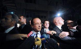 François Hollande le 1er octobre 2012, à Echirolles, en Isère, où ont été tués deux hommes le 28 septembre.