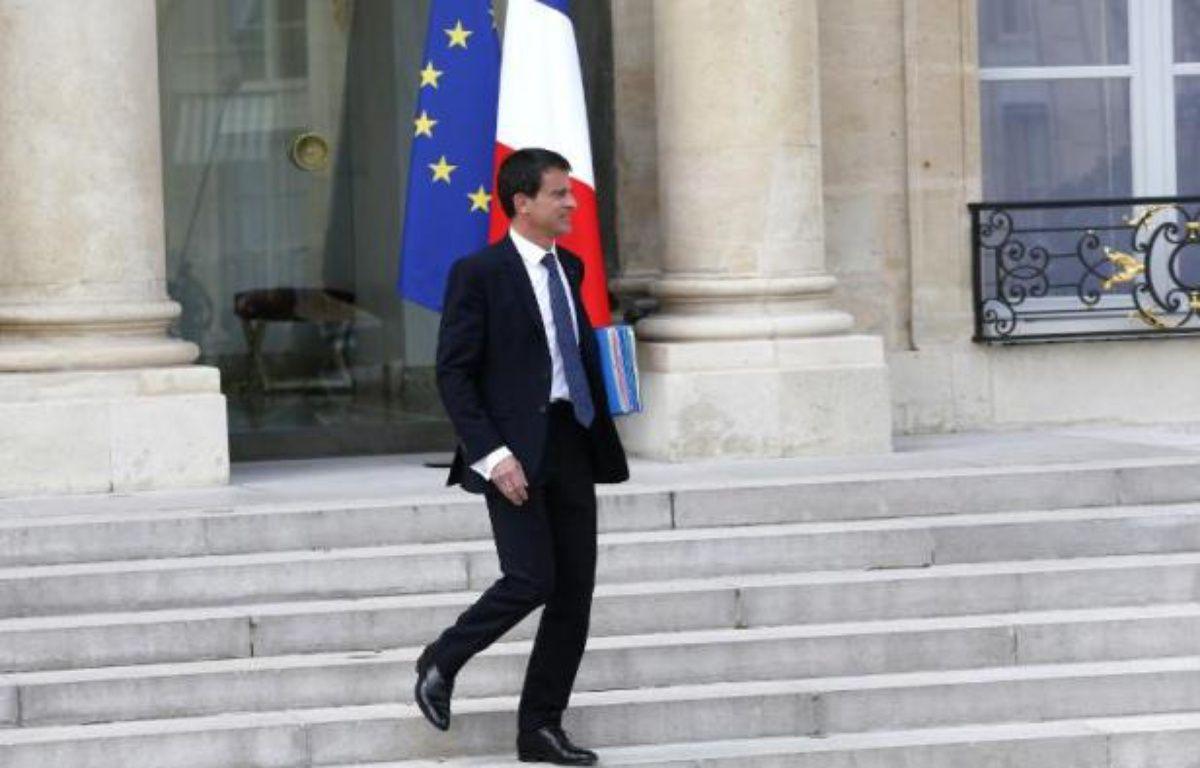 Le Premier ministre Manuel Valls quitte l'Elysée, le 27 mai 2015 – THOMAS SAMSON AFP