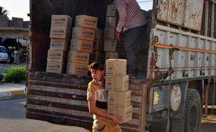 Des aides de l'UNICEF sont distribuées aux familles déplacées, le 24 juin 2014 à Diyala, près de Bagdad
