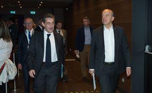 Nicolas Sarkozy et Alain Juppé, le 2 juillet à la Mutualité à Paris.