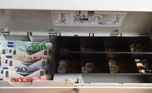 Un tiroir-caisse. Illustration.