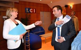 Nadine Morano et Florian Philippot réunis pour un débat télévisé sur la chaîne LCI pour les élections européennes dans la région Grand Est, le 23 avril 2014.