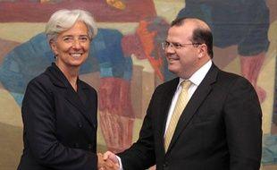 La ministre de l'Economie, Christine Lagarde, avec le président de la Banque centrale du Brésil, Alexandre Tombini, à Brasilia le 31 mai 2011.