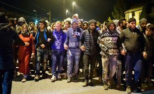 Migrants et réfugiés à leur arrivée le 20 octobre 2015 dans un centre à Sentilj à la frontière entre la Slovénie et l'Autriche