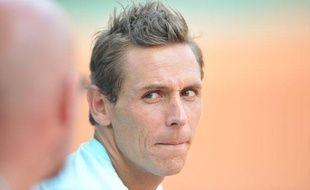 Le Français Nicolas Devilder en discussion avec son entraîneur, le 31 mai 2012, àRoland-Garros.