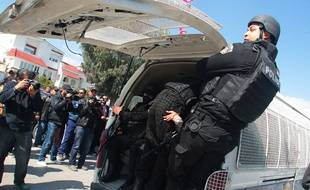 Tunisian policemen secure the Bardo museum are evacuated in Tunis, Wednesday, March 18, 2015 in Tunis, Tunisia after gunmen opened fire at the leading museum in Tunisia's capital. Tunisia's prime minister says 21 people are dead after an attack on a major museum, including 17 foreign tourists — and that two or three of the attackers remain at large/HAMMI_1730.08/Credit:MOHAMED HAMMI/SIPA/1503181740