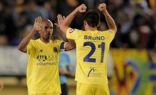Villarreal (3-2 à Gijon) et Grenade (2-1 devant l'Espanyol Barcelone) ont obtenu deux victoires importantes dans l'optique du maintien mardi lors de la 20e journée du Championnat d'Espagne reportée à cause d'une grève des joueurs en août, le Real pouvant être titré dès mercredi.