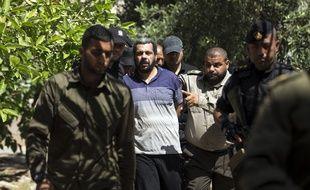 Accusés de l'assassinat d'un commandant du mouvement islamiste pour le compte d'Israël, Hisham al-Aloul (photo), Achraf Abou Leïla et Abdallah al-Nasha ont été condamné à mort