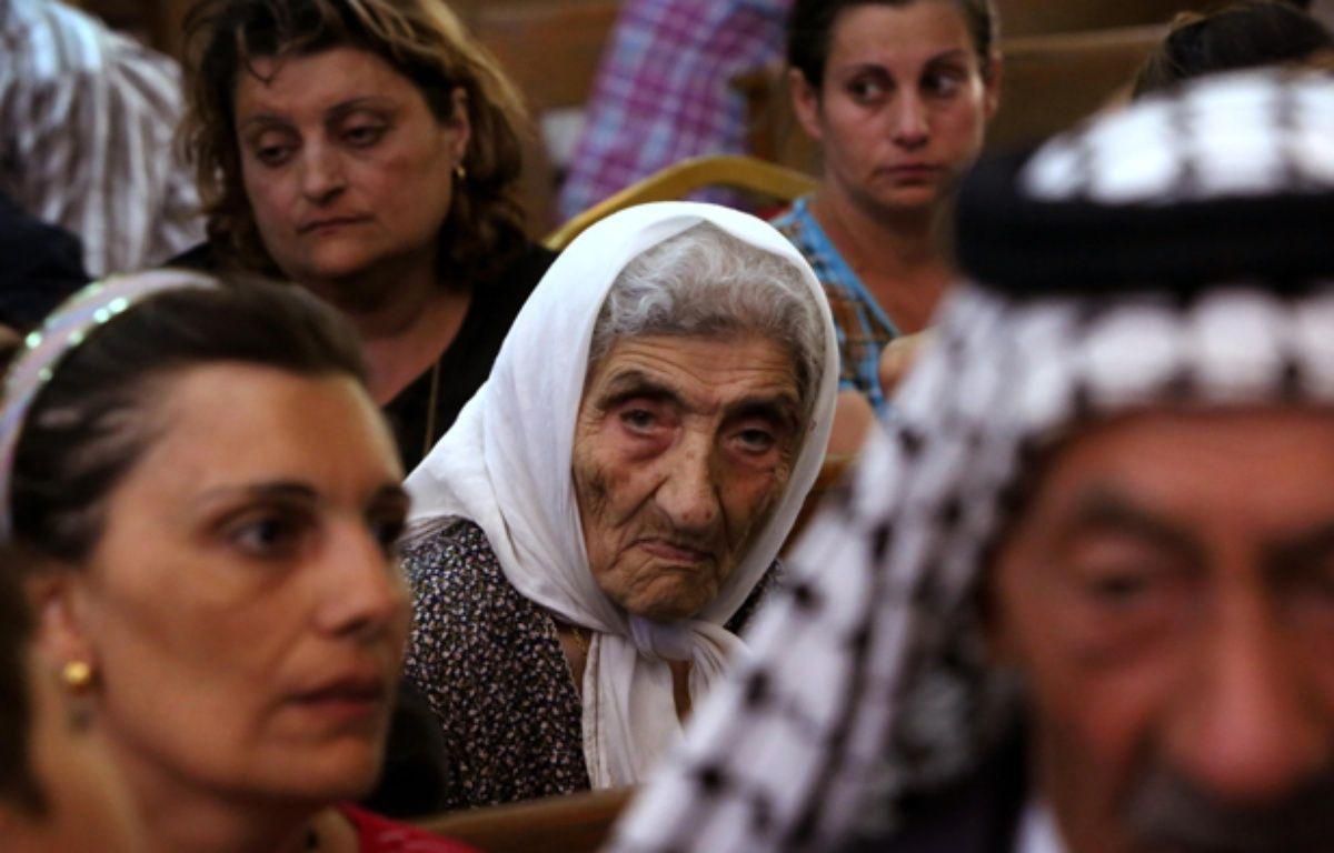 Les chrétiens d'Irak fuient vers le nord du pays. – S.HAMED / AFP