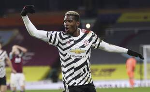 Manchester United's Paul Pogba celebrates after scoring during the English Premier League soccer match between Burnley and Manchester United in Burnley, England, Tuesday, Jan. 12, 2021. Manchester won the match 1-0.(Clive Brunskill/Pool via AP)/XLP264/21012813355391/POOL PHOTO/2101122339