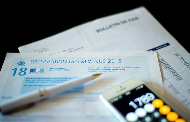 648x415 illustration formulaire de declaration d impots argent calculatrice et stylo toulon france 28 04