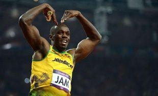 """Usain Bolt s'est réjoui de terminer les jeux Olympiques de Londres samedi avec un 3e titre sur le relais 4x100 m et un nouveau record du monde qui lui fait dire: """"Nous allons continuer à repousser les barrières"""" du temps."""