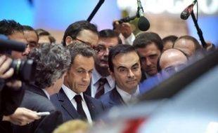"""Nicolas Sarkozy a annoncé jeudi le lancement d'un plan gouvernemental de 400 millions d'euros destiné à favoriser la recherche et le développement des """"véhicules propres"""", lors d'un discours prononcé au salon mondial de l'automobile à Paris."""
