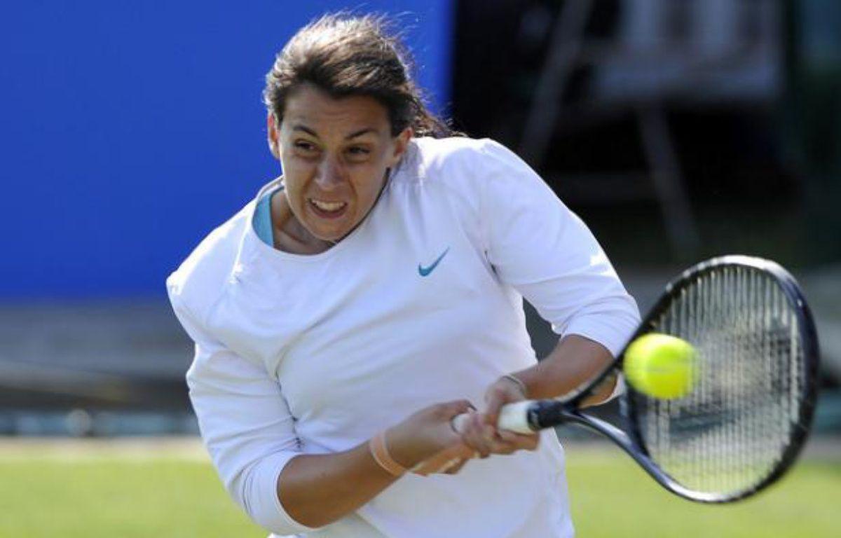 La joueuse de tennis française Marion Bartoli, lors de sa victoire à Eastbourne, le 16 juin 2011 contre Viktoria Azarenka. – D.Martinez/REUTERS