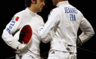 Fabrice Jeannet of France (R) and Matteo Tagliariol of Italy greet each other after their men's individual epee fencing final at the Beijing 2008 Olympic Games, August 10, 2008. REUTERS/Laszlo Balogh (CHINA)