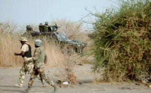 Des membres présumés du groupe islamiste Boko Haram ont tué onze personnes jeudi dans une localité du nord-est du Nigeria où ils ont ouvert le feu sur policiers et civils, a-t-on appris vendredi auprès d'habitants et d'un élu.