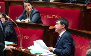 Cécile Duflot et Manuel Valls, le 1er octobre 2013 à l'Assemblée nationale, lorsque l'une était ministre du Logement et l'autre ministre de l'Intérieur.