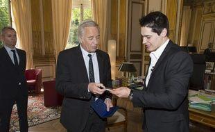 Xavier Koenig décoré par François Rebsamen
