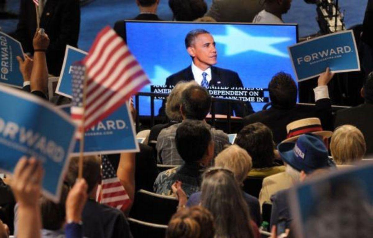 """Le président Barack Obama a reconnu jeudi que le slogan d'espoir sur lequel il avait été élu il y a quatre ans avait été """"mis à l'épreuve"""" mais promis aux Américains que le changement restait possible, en sollicitant leurs suffrages pour un second mandat. – Mladen Antonov afp.com"""