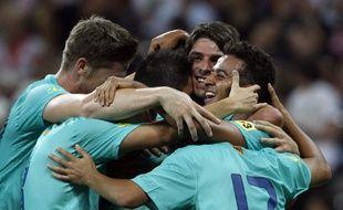 Les joueurs du Barça, lors de leur victoire contre le Bayern Munich en amical, le 27 juillet 2011.
