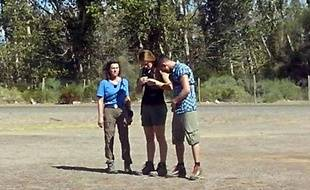 """This picture taken on March 9, 2015 in the Argentine province of La Rioja shows the three French sports stars (from L) Champion sailor Florence Arthaud, Olympic gold medallist swimmer Camille Muffat, and Olympic boxer Alexis Vastine, moments before they enters a helicopter that crashed while filming a reality TV show. Arthaud, Muffat and Vastine were among 10 people killed when two helicopters filming the survival series """"Dropped"""" smashed into each other in the rugged mountains of La Rioja province, local officials said.     AFP PHOTO / ALDO PORTUGAL ***BEST QUALITY AVAILABLE***"""