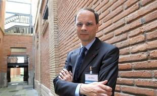 """FILES - Picture taken on June 2, 2008 shows French economist Jean Tirole posing at the School of Economics in Toulouse, France. Tirole won the 2014 Nobel Economics Prize on October 13, 2014. He was honoured """"for his analysis of market power and regulation"""", the Royal Academy of Sciences said in a statement.  AFP PHOTO / ERIC CABANIS"""