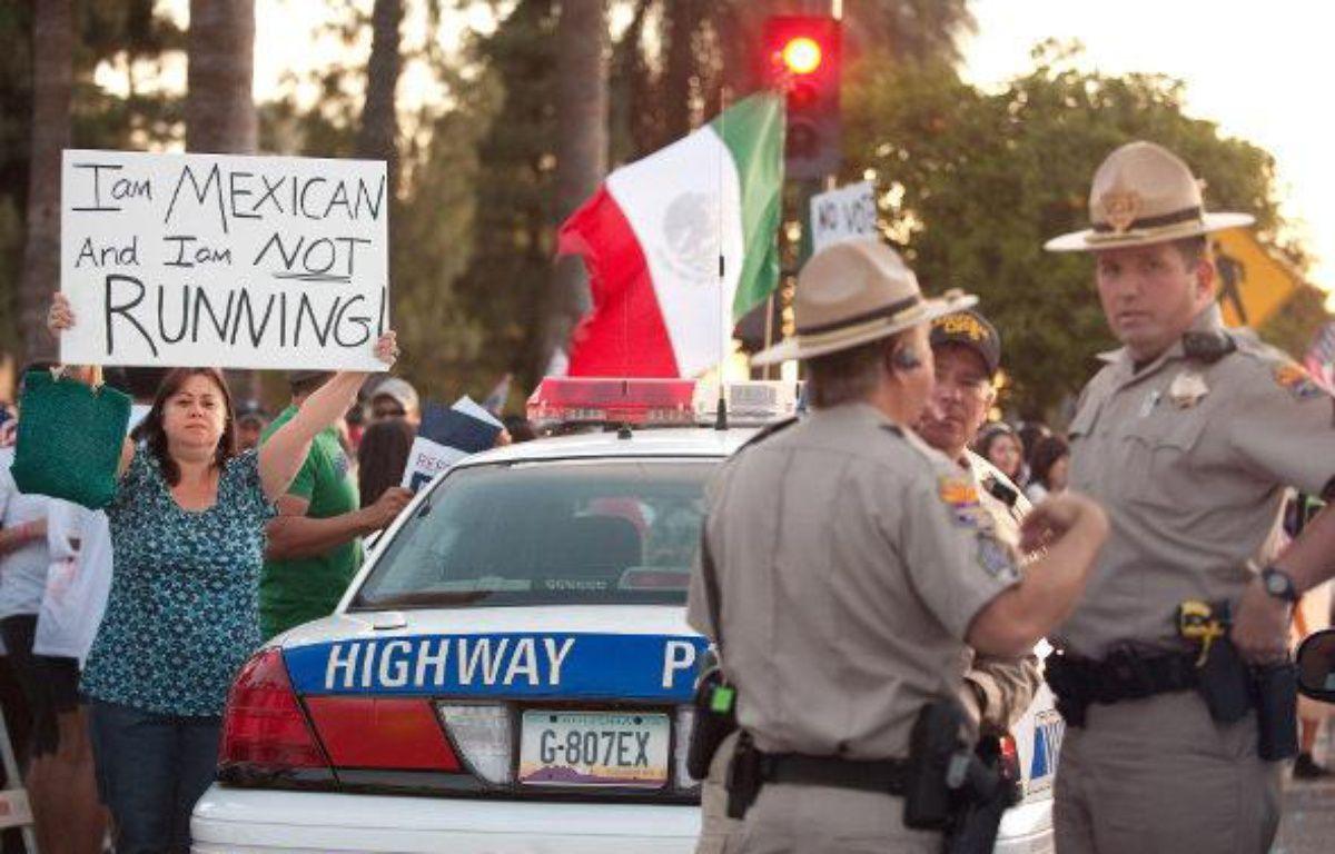 Une manifestante opposée à la réforme de l'immigration en Arizona, le 1er mai 2010 – AFP/P.RICHARDS