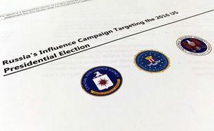 Le rapport publié le 6 janvier 2016 par le FBI, la CIA et la NSA accusent la Russie d'avoir ordonné une campagne d'influence visant à «discréditer Hillary Clinton et à aider Donald Trump»
