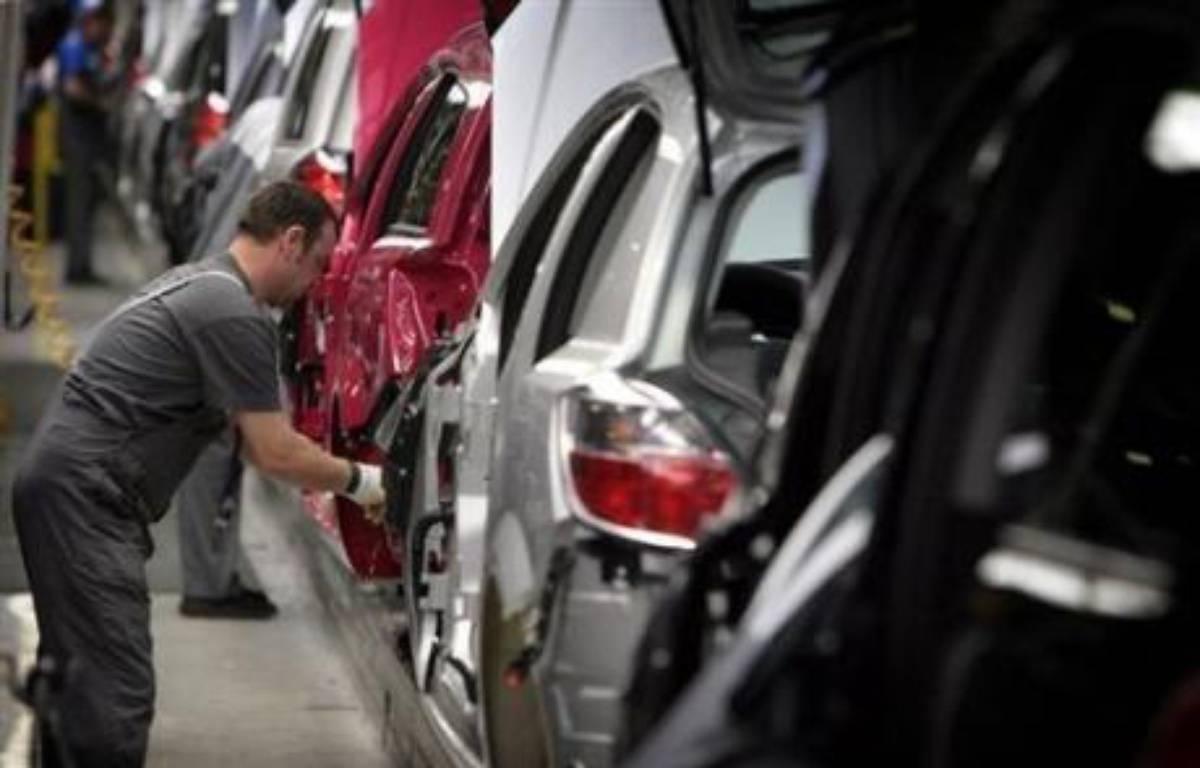 Très touché par la chute de la demande, le numéro un mondial de l'automobile, l'américain General Motors, pourrait étendre ses mesures de chômage technique à toutes ses usines européennes, où il veut baisser sa production de 40.000 véhicules d'ici la fin 2008. – Volker Hartmann AFP/Archives