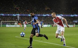 Glk en duel avec l'attaquant iranien Rezael, au match aller contre Bruges.