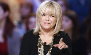 """French singer France Gall takes part in the TV show """"Le grand journal"""" on a set of French TV Canal+, on October 30, 2012 in Paris."""